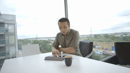 Young man sitting in office