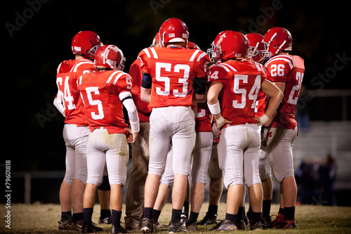 Football Team in a Huddle - 79601818