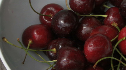 CU BOWL OF CHERRY'S ON GARDEN TABLE