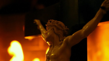 Christ Figure with Flame Background
