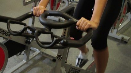 Group working out on bicycles in a gym