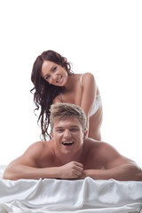 Grinning girl doing massage to her lover