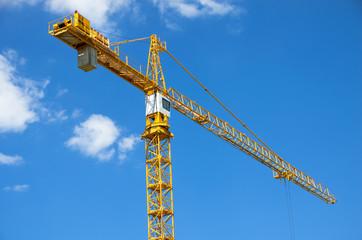 Yellow crane on blue sky.