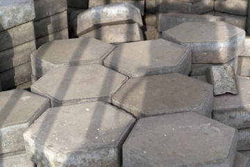 Stack of grey hexagonal tiles