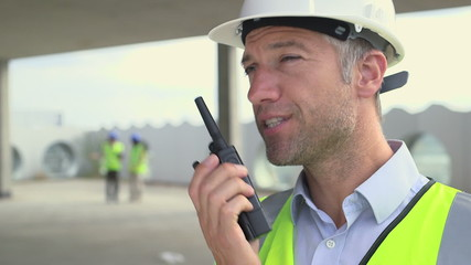 Man talking on walkie-talkie