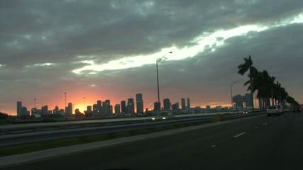 Driving along road at sunset miami beach