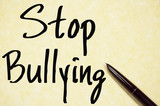 stop bullying text write on paper poster