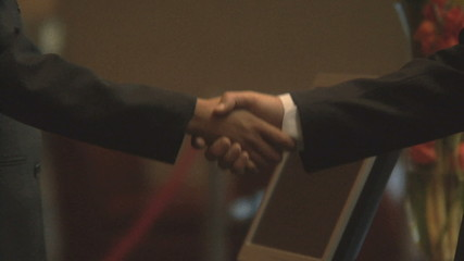 CU OF BUSINESSPEOPLE SHAKING HANDS