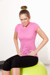 Woman suffering from stomachache during workout