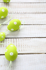 Easter garland on wooden boards