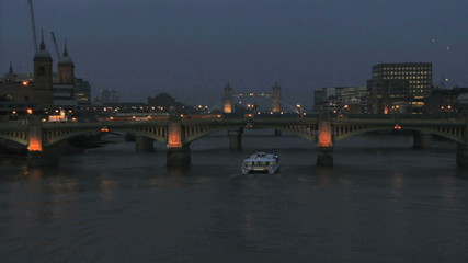 Time lapse boat on thames river at night