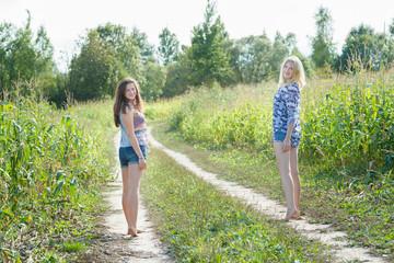 Friends standing on farm field road