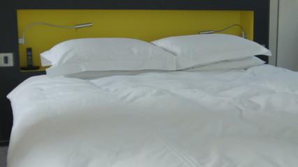 Track, medium shot on bedroom in contemporary house, UK