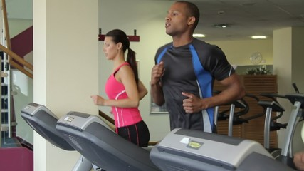 Group running on treadmills, cardio workout exercise in gym