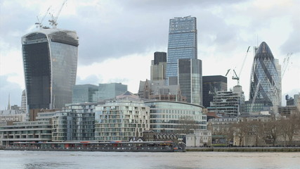 The view from the Southbank of skyscrpaers, office buildings and the River Thames at sunset