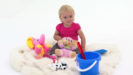 Baby Girl With Toys On White Cover