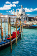 Grand Canal in Venice, Italy, with colorful gondola boats