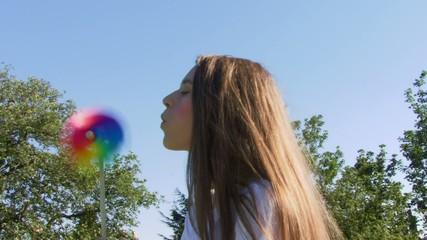Female blowing pinwheel