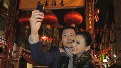 Couple taking picture in chinatown