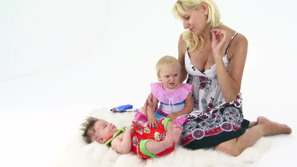 Happy Mother With Two Small Children