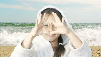 kid showing gesture heart of the sea