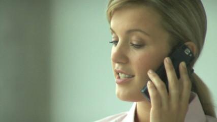 CU FEMALE ON PHONE IN OFFICE