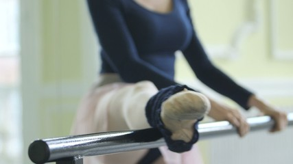 CU Female Ballet Dancer stretches using the Studio Ballet barre