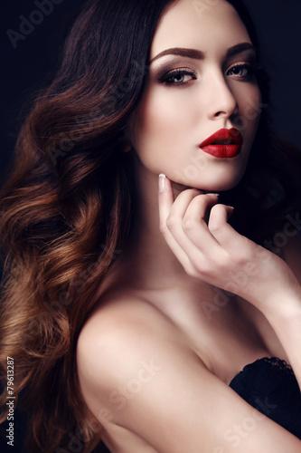 Fototapeta beautiful sexy woman with dark hair and bright makeup