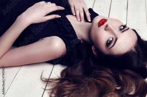 Poster beautiful sexy woman with dark hair and bright makeup