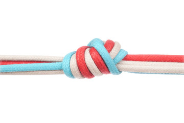 Ropes or shoelaces tied in a knot on a white background