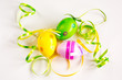 Three Easter eggs, green and yellow ribbons