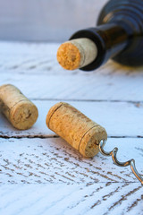 A bottle of wine and a corkscrew in the cork