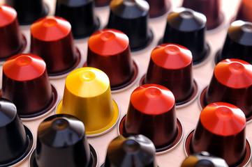 Set of espresso coffee capsules aligned diagonally