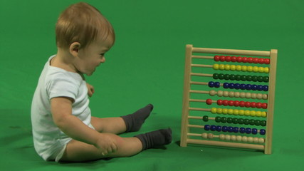 LS OF A BABY PLAYING WITH AN ABACUS