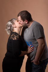 Beautiful xxl woman kissing her husband