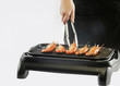 prawns are grilled on the electric stove - 79615830