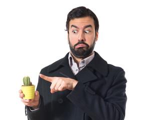 Man holding a cactus