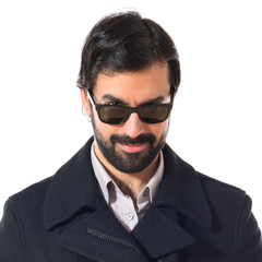 Handsome man with sunglasses over white background