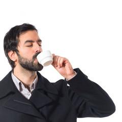 Brunette man drinking coffee