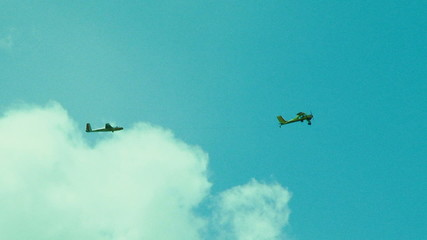 Glider Towing Plane High In the Sky
