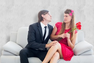 Composite image of cute geeky couple