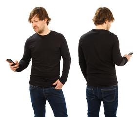 Man wearing blank black shirt holding phone