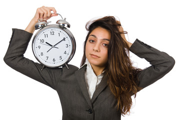 Businesswoman with clock missing her deadlines