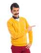 Man with moustache pointing to the lateral - 79619403