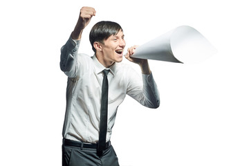 Young businessman shouting with a papers megaphone