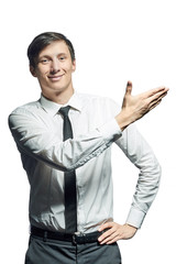 Young smiling businessman shows something