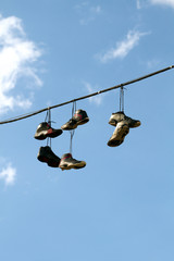 Sneakers Hanging on a Telephone Line