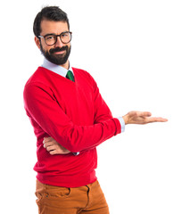 Hipster man presenting something