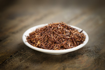 rooibos tea on a small white plate