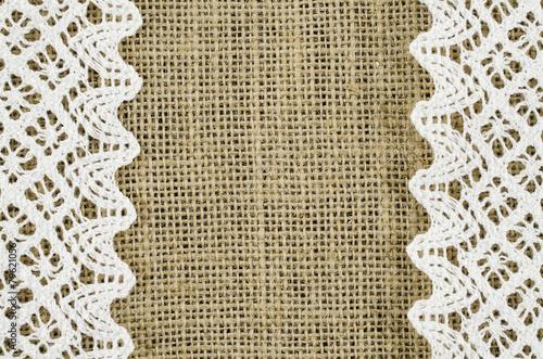 Frame of white napkin on linen background